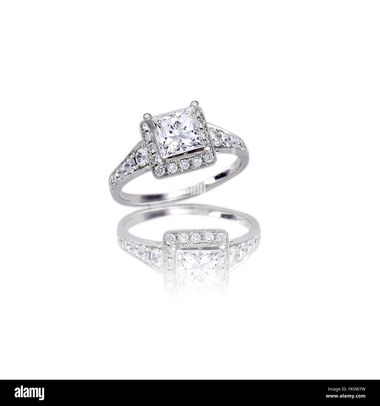 Beautiful Diamond Wedding Band Princess Cut Halo Setting Engagement Ring Isolated On White With A Reflection