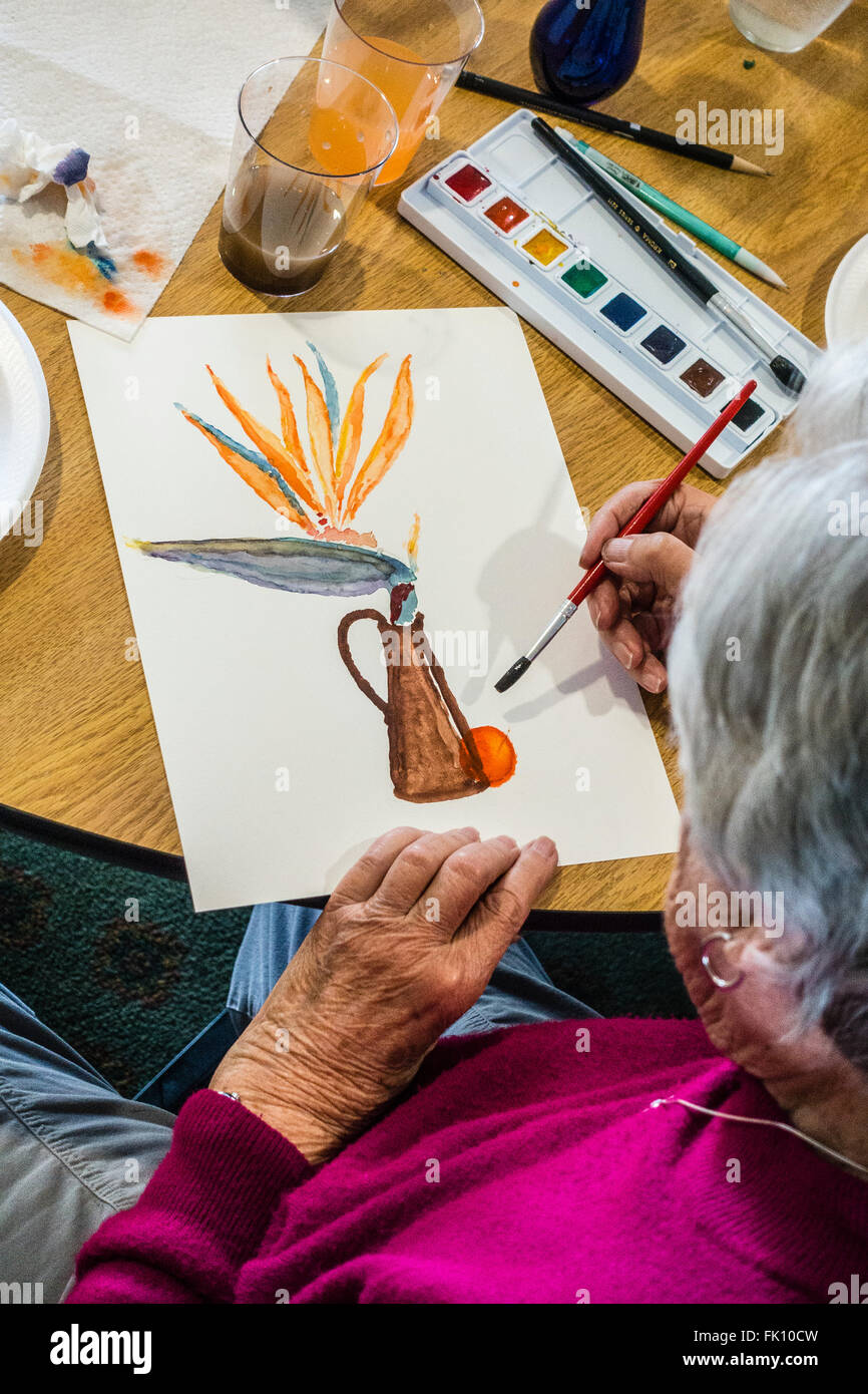 A Female Senior Citizen Paints In A Watercolor Class For Seniors At Garden  Court Senior Residence In Santa Barbara, California