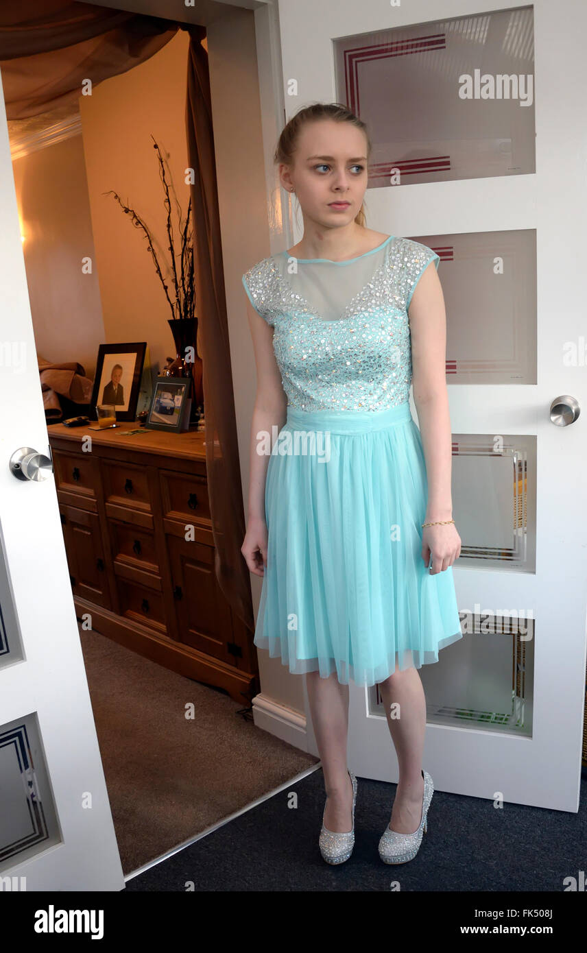 Young female teenager ready for school prom in new dress and shoes ...