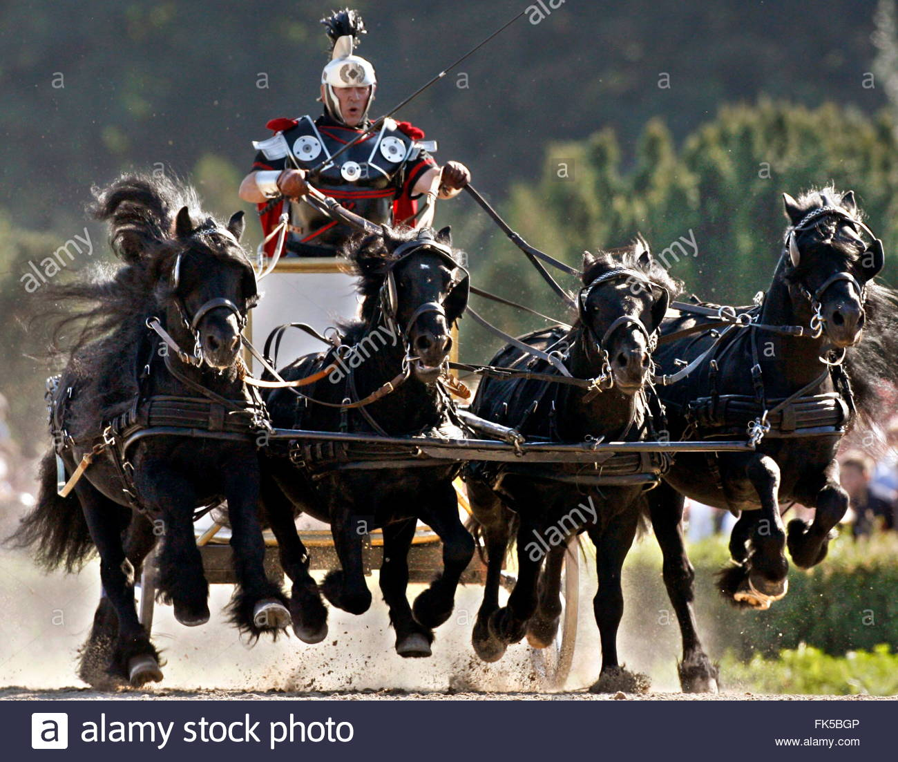 [Image: a-charioteer-spurs-his-quadriga-during-t...FK5BGP.jpg]