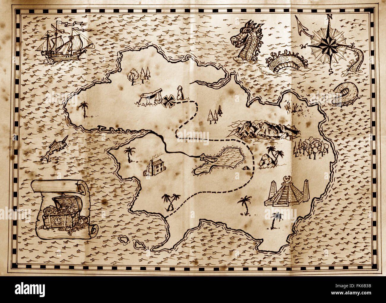 old treasure map used by pirates to find hidden treasure  stock photo. old parchment pirate island map stock photo royalty free image