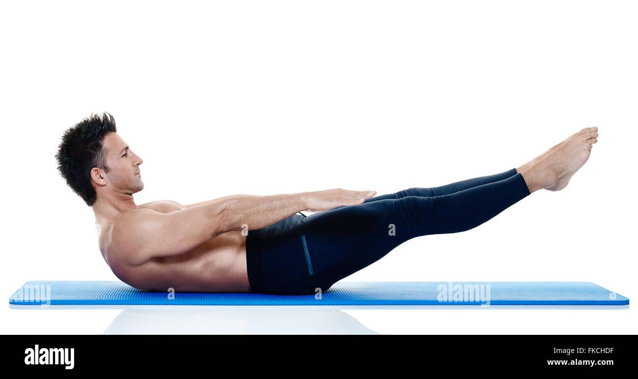 one caucasian man exercising fitness pilates exercices isolated on stockfoto lizenzfreies bild. Black Bedroom Furniture Sets. Home Design Ideas