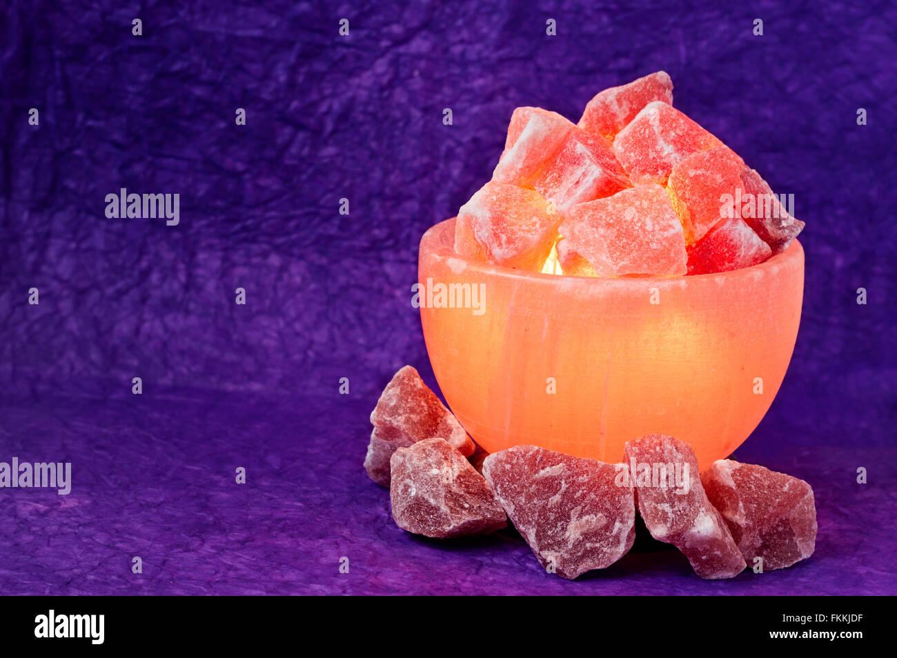 http://c8.alamy.com/comp/FKKJDF/turned-on-himalayan-pink-salt-lamp-carved-as-a-bowl-with-a-wrinkled-FKKJDF.jpg