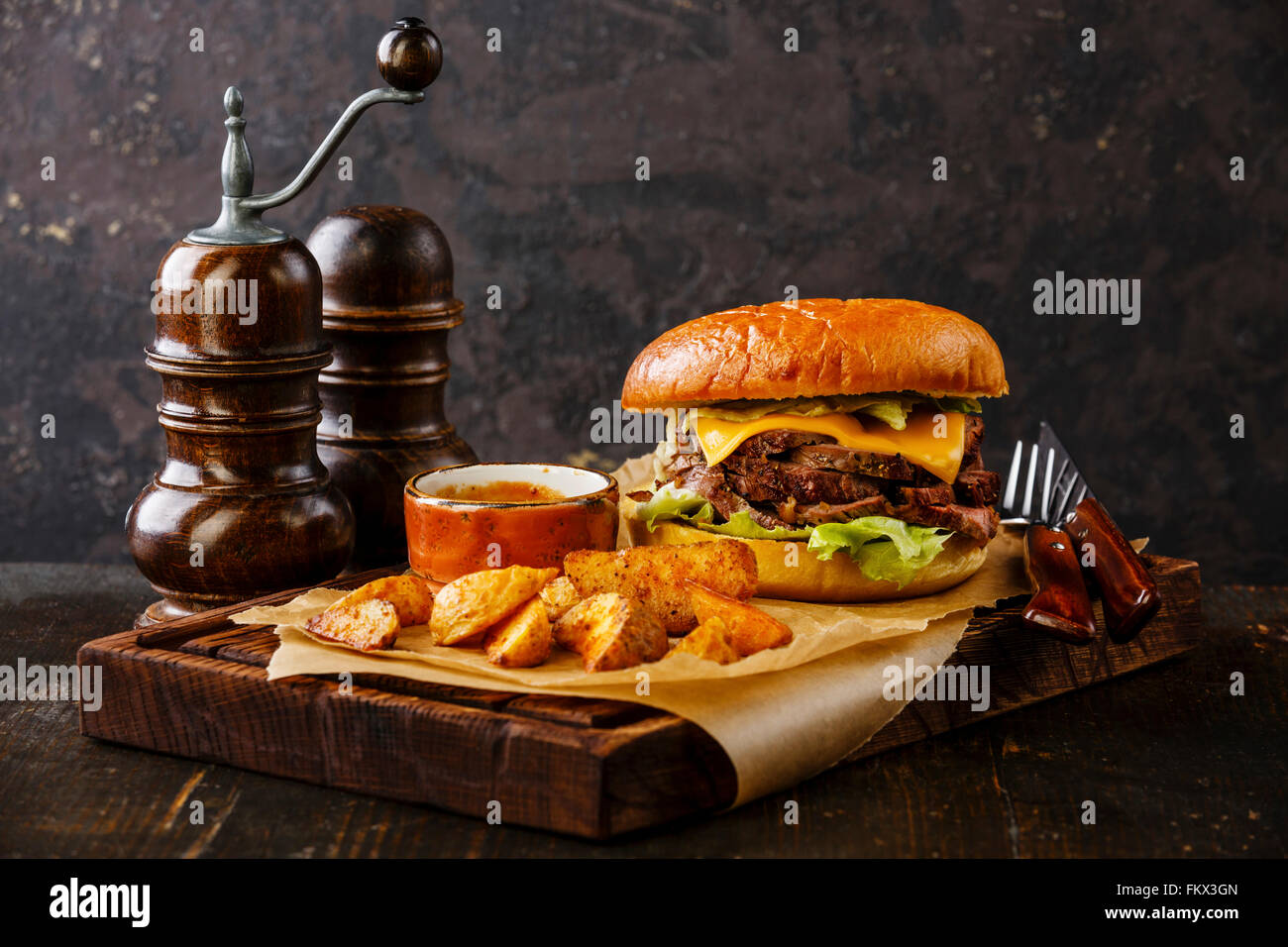 Sliced roast beef package - Pastrami Burger With Sliced Roast Beef And Potato Wedges On Dark Background