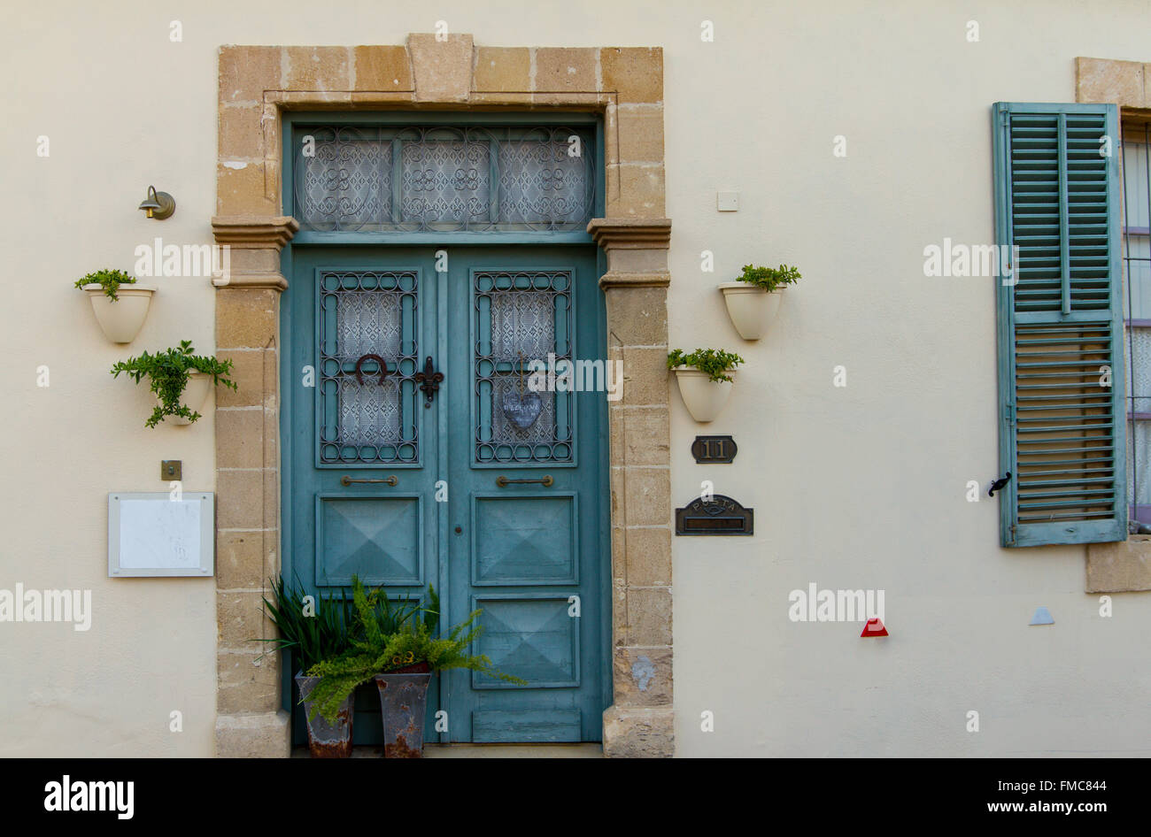 Classic style cyan wooden door house entrance and window in the ...