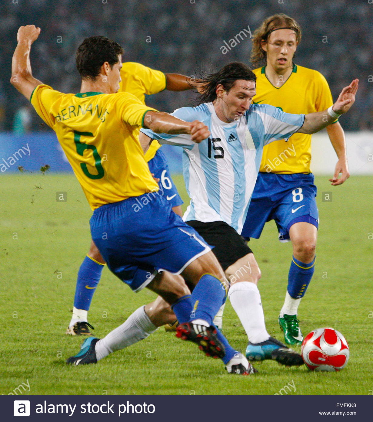 FKK - Brazil Stock Photo - epa01456932 Lionel Messi from Argentina (C) vies with Hernanes (L) and Lucas (R) from Brazil during the men's Football semi-final match ...