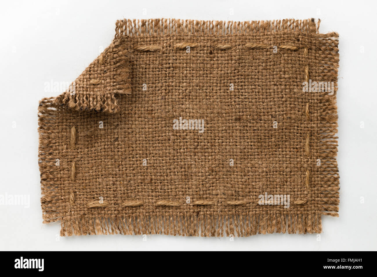 Frame of burlap with curled edges, lies on a white background, can ...