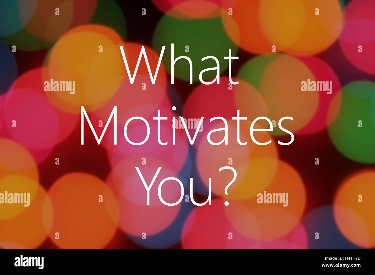 what motivates you text on colorful bokeh background stock photo stock photo what motivates you text on colorful bokeh background