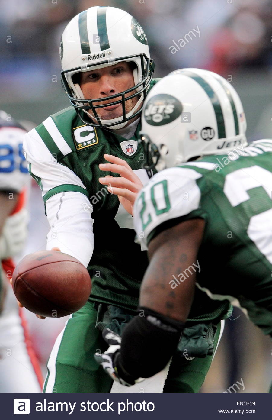 Jerseys NFL Cheap - The Jets' Brett Favre (l) Hands Off To Thomas Jones (r) During The ...