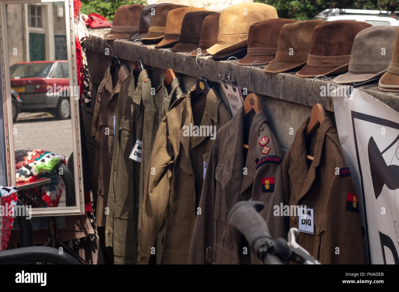 Old vintage hats and army military uniform selection at car boot sale in bath uk