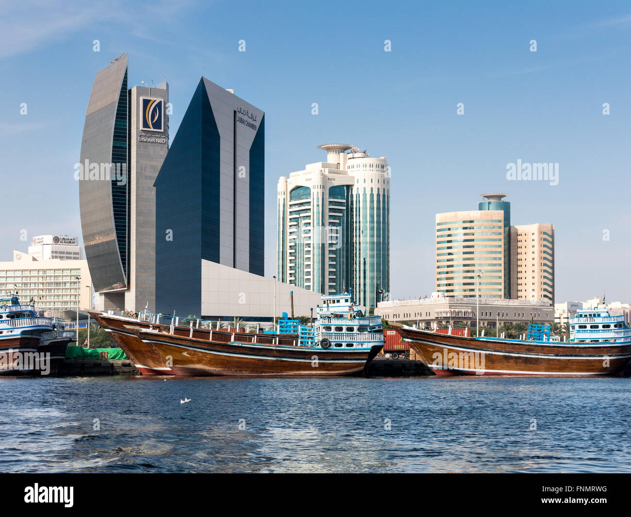 Dhows And Buildings Of National Bank Of Dubai, Dubai Creek Tower And Al  Reem Tower In Rigga Al Buteen Centre In Dubai, UAE