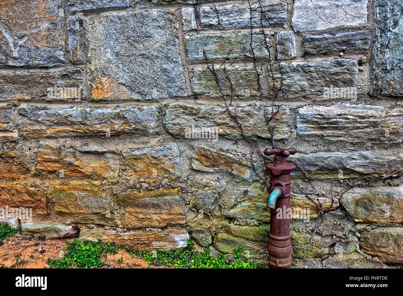 Old Rusty Water Faucet on side of building Stock Photo: 99483706 - Alamy