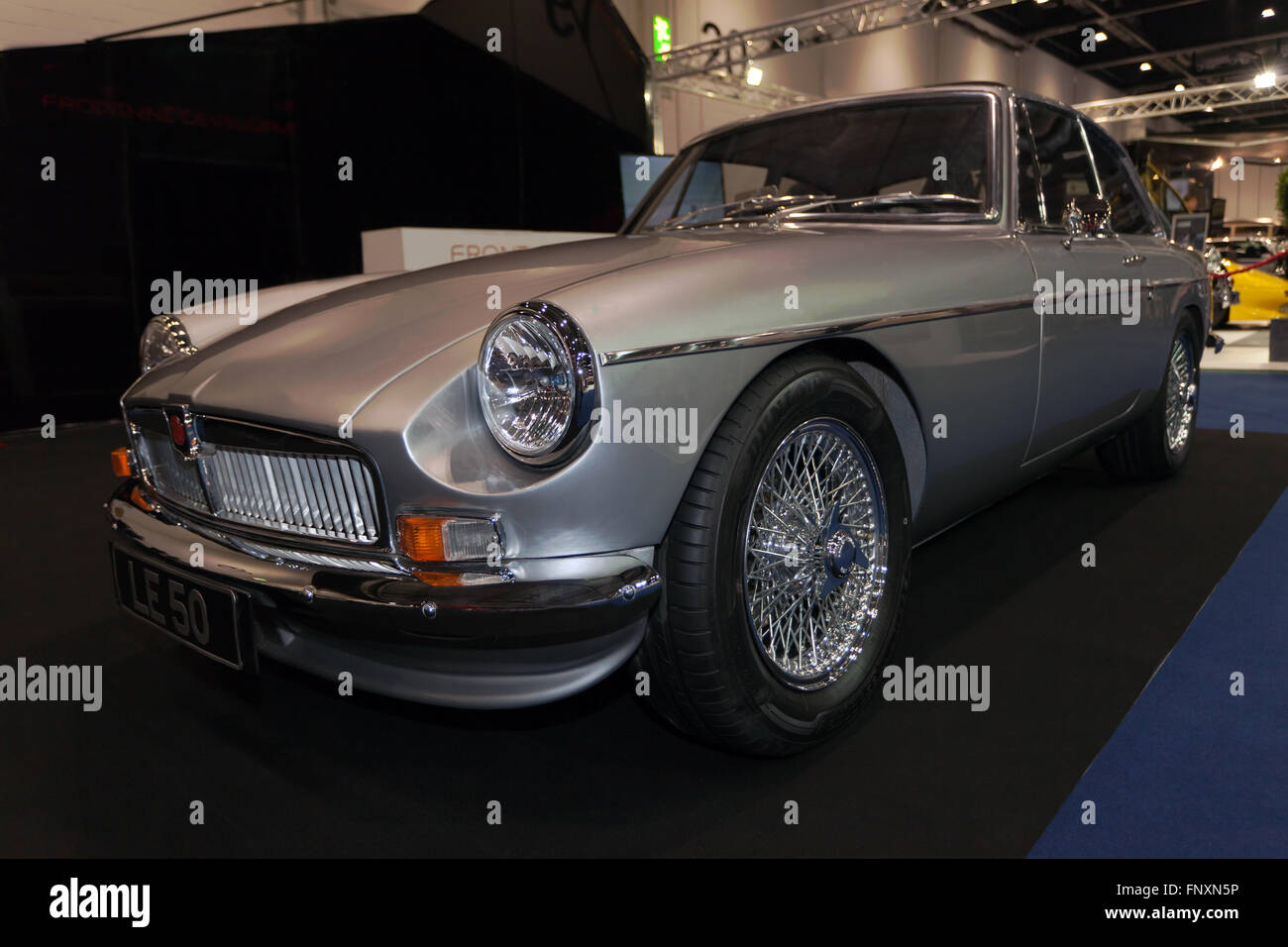 A beautiful restored silver mgb gt on static display at the 2016 london classic car