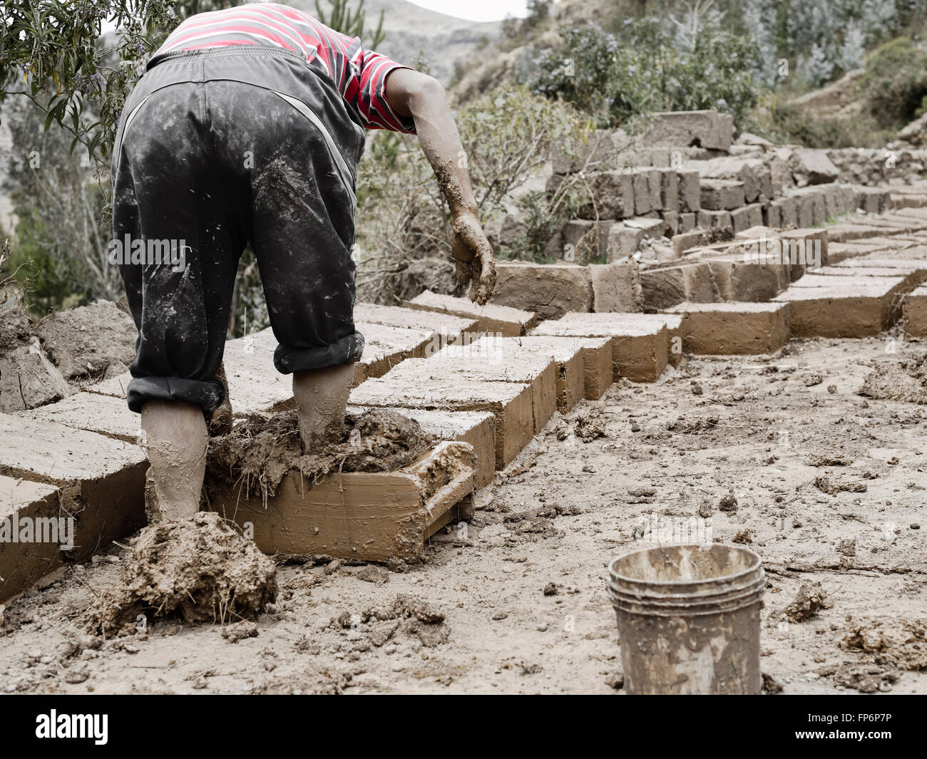 http://c8.alamy.com/comp/FP6P7P/boy-making-traditional-adobe-mud-bricks-to-build-his-own-house-in-FP6P7P.jpg