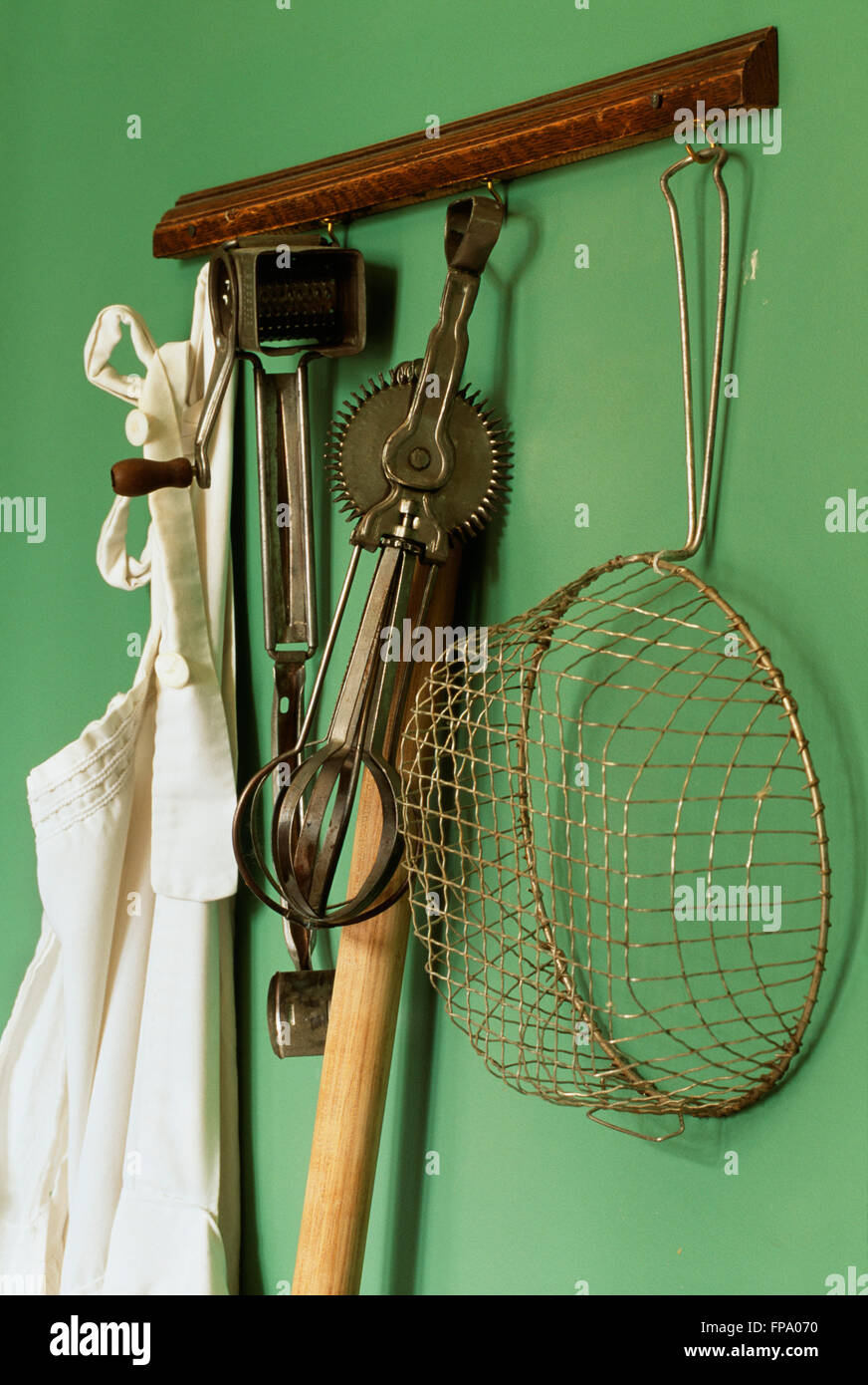 Vintage kitchen gadgets - Stock Photo Vintage Kitchen Gadgets Hanging From A Rack