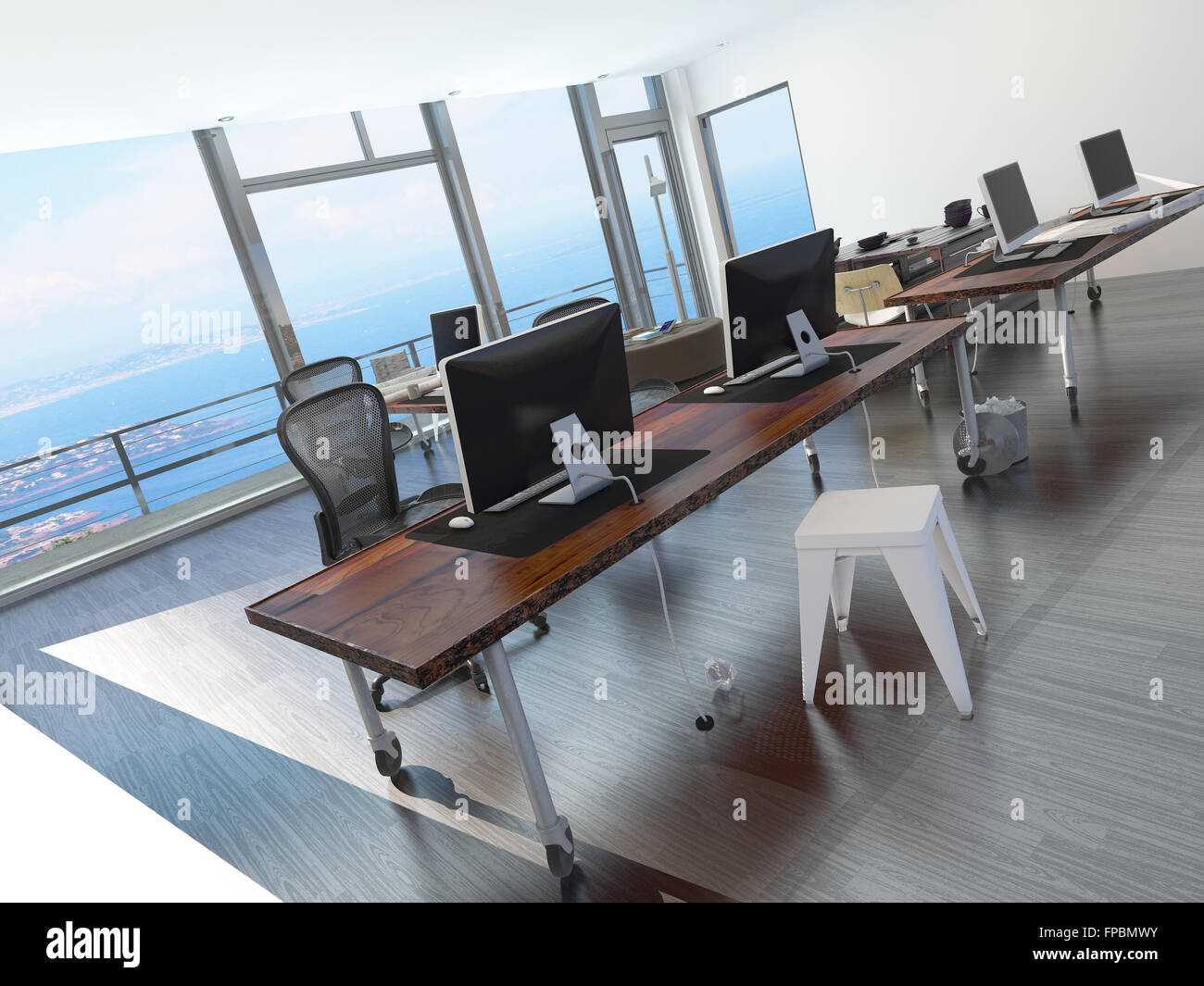long office table. modern minimalist coastal office overlooking the sea with a long table several computer workstations