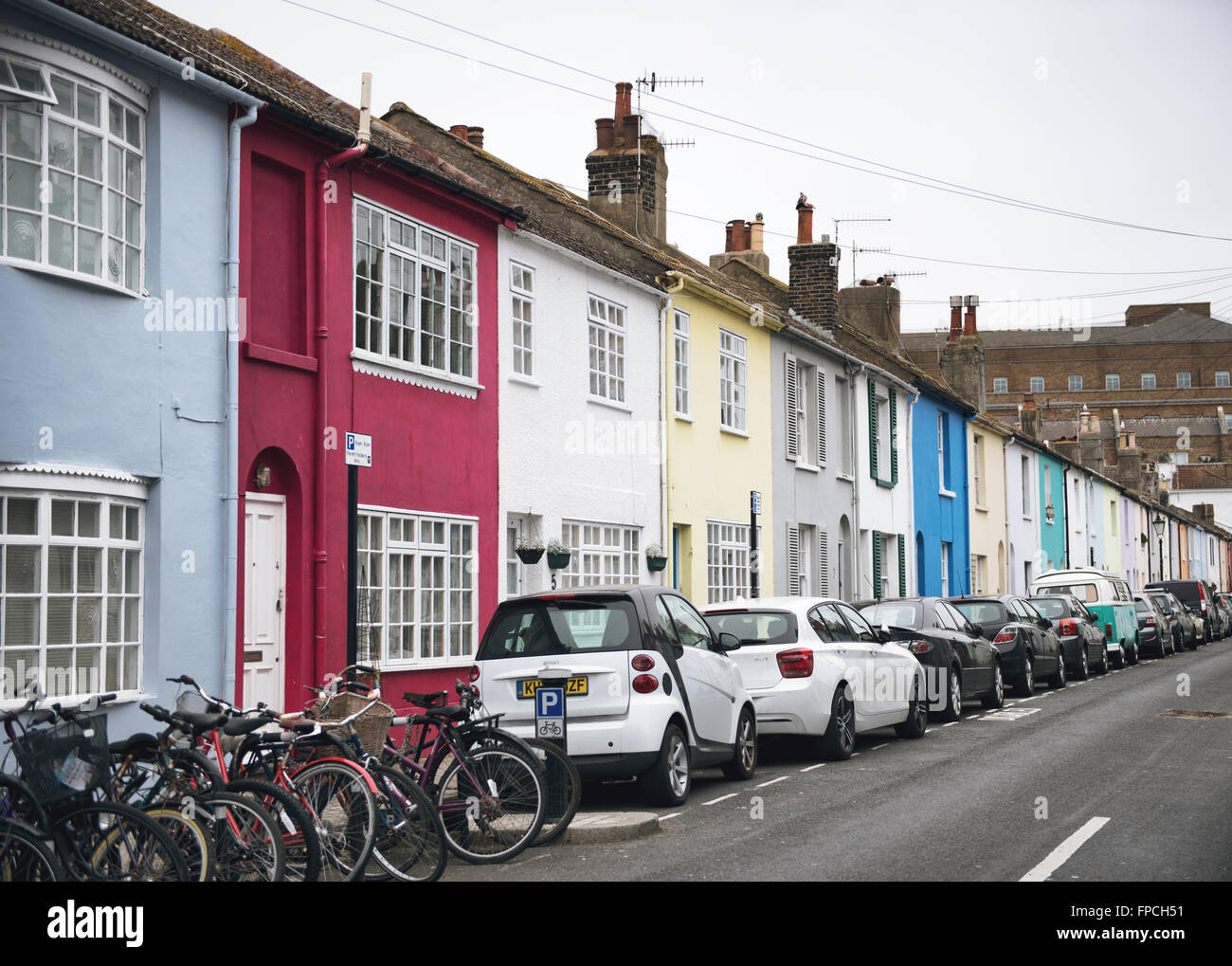 Car Parking on Street Side Fronting Assorted Colors Houses Stock ...