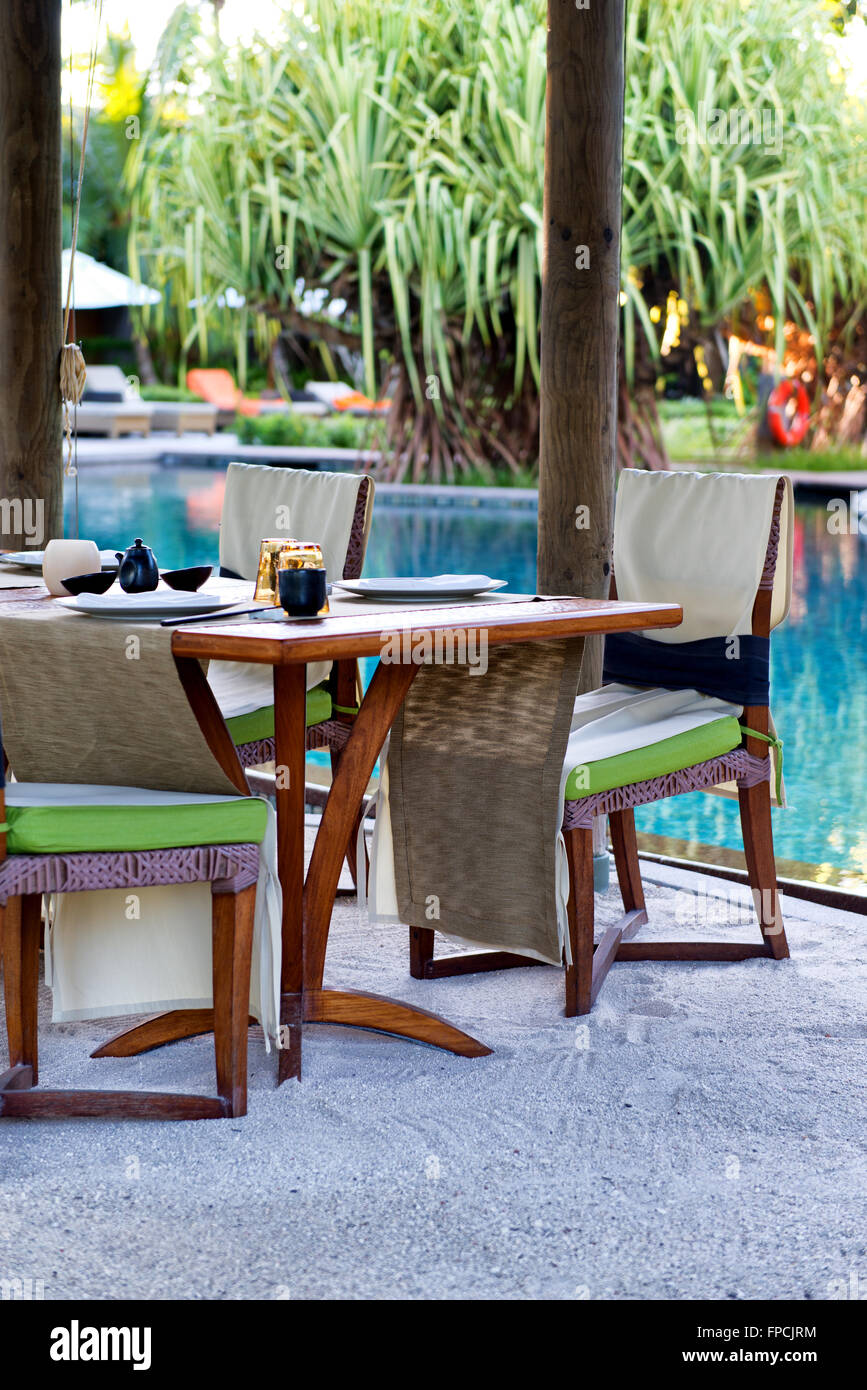 Elegant Poolside Table With Place Settings At Outdoor Asian Restaurant