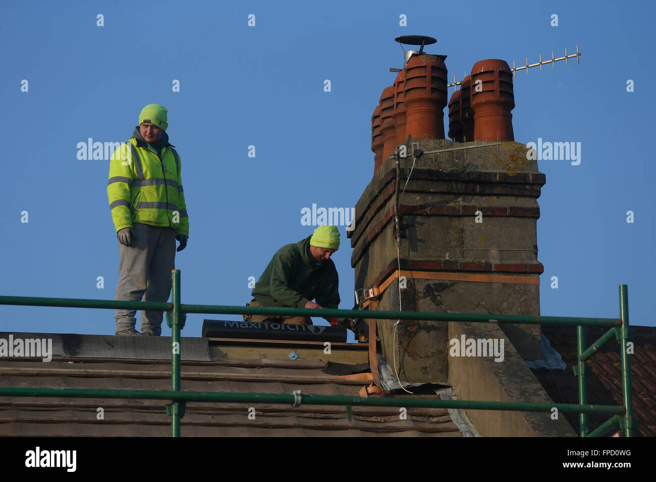 Wg Builders builders removing a roof to build a loft conversion on a