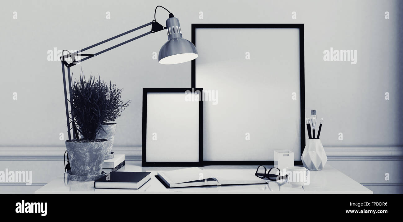 Blank picture frames on a simple modern desk or writing table with blank picture frames on a simple modern desk or writing table with an open journal and anglepoise lamp in monochromatic black and white decor 3d rendering jeuxipadfo Images
