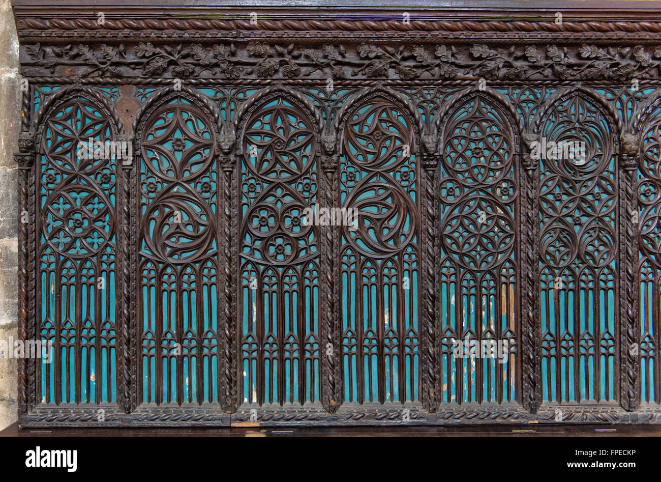Architectural detail of blue windows with intricate wood for Architectural window designs