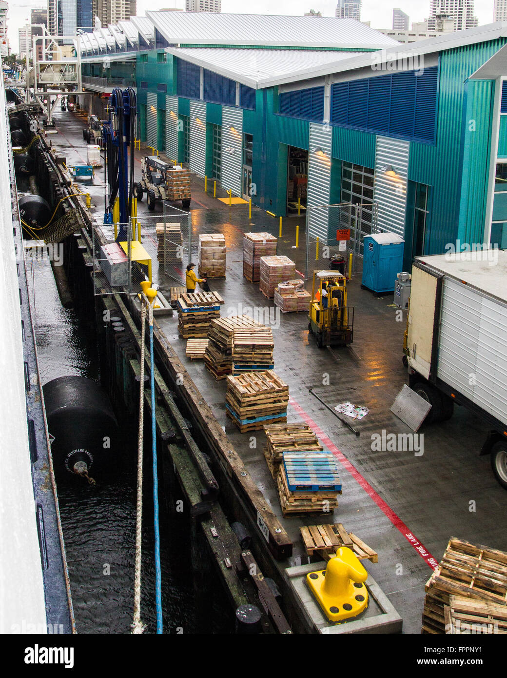 A Busy Loading Dock At A Cruise Ship Terminal In San Diego With - Where do cruise ships dock in san diego