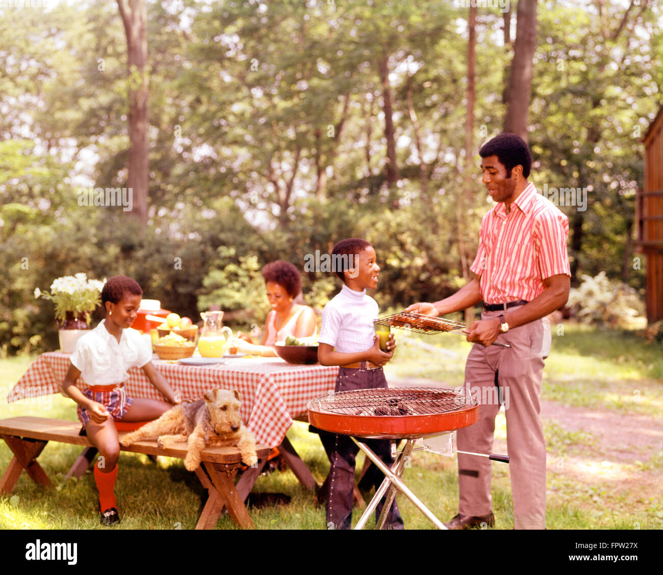 1960s 1970s african american family backyard bar b que mother