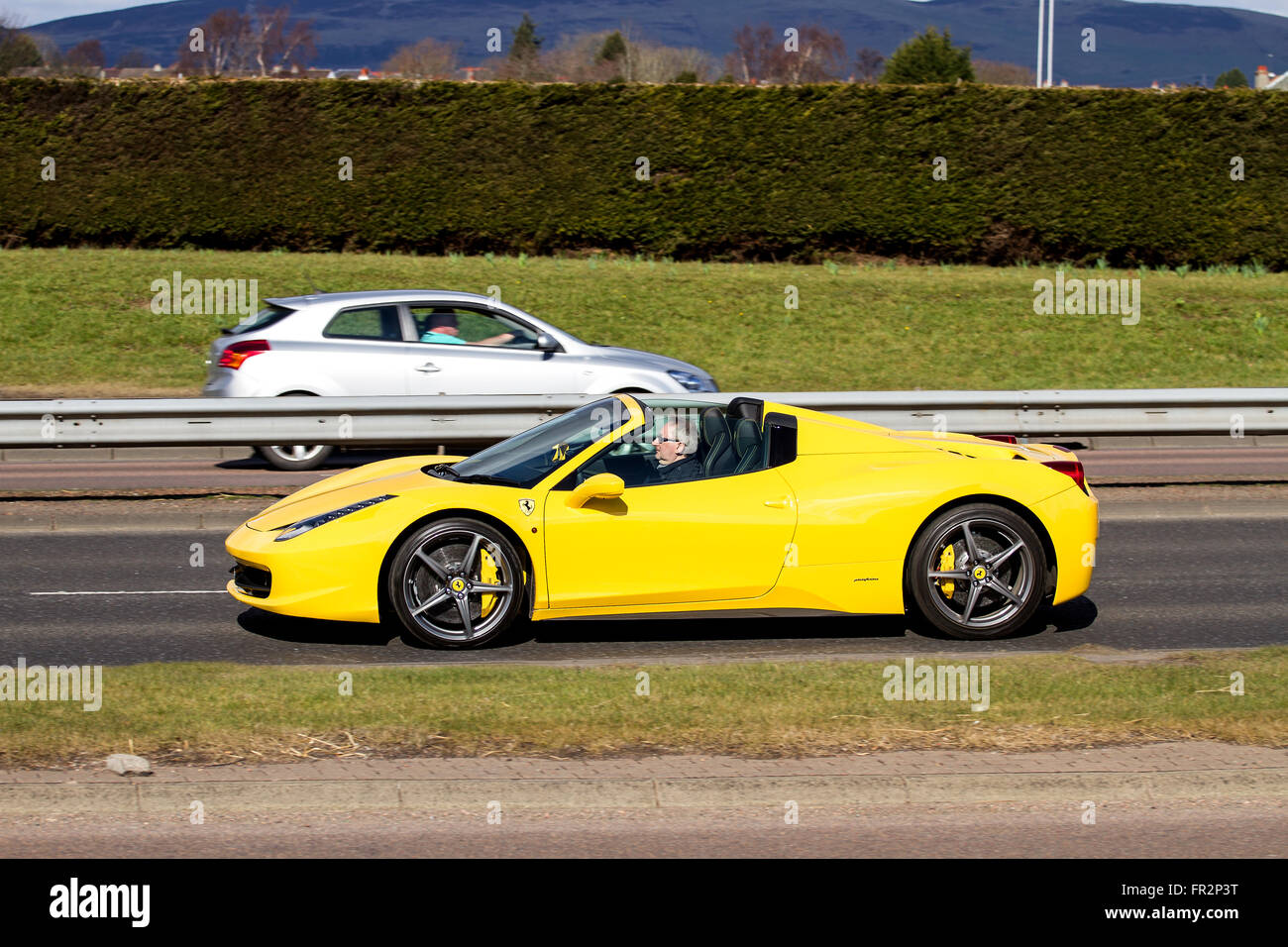 a yellow ferrari 458 italia spider convertible sports car travelling stock photo royalty free. Black Bedroom Furniture Sets. Home Design Ideas
