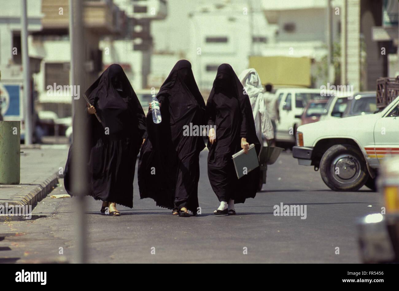 Stock photo three saudi veiled women walking in al khobar eastern province saudi arabia