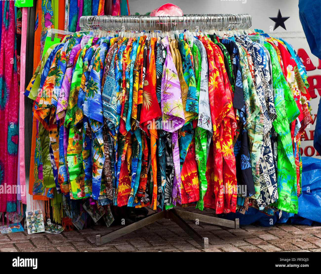 A rack of colorful shirts for sale in a market at St ...