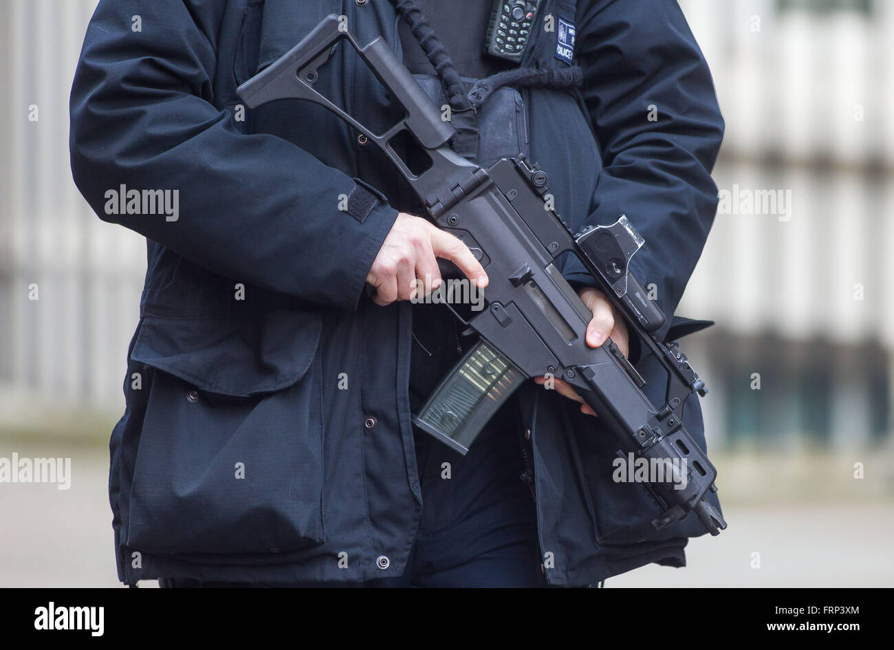 Stock On Gun Cabinet Armed Police Officer Patrols Downing Street With A Machine Gun