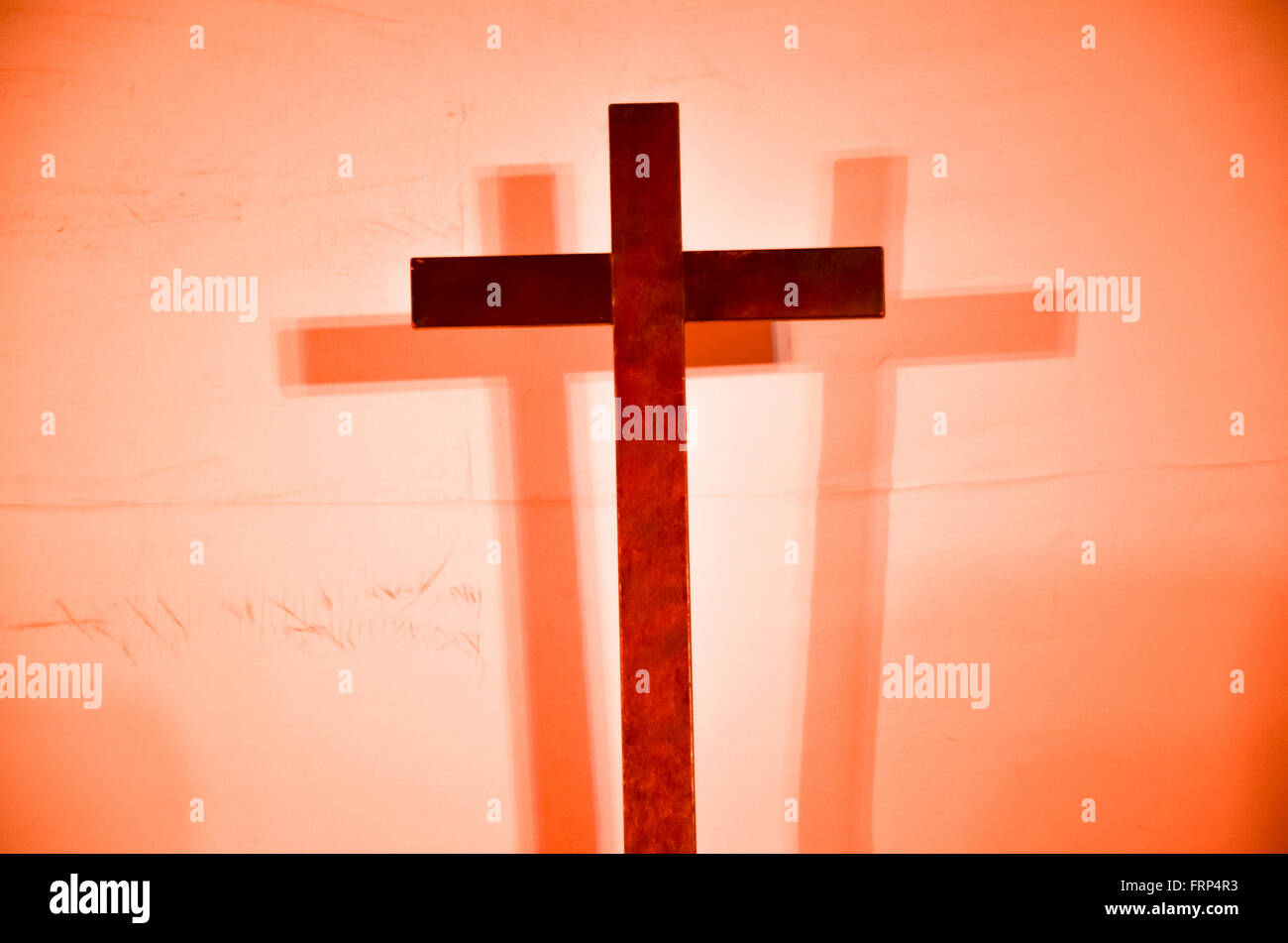 the cross of christ with the two faded images of the sinners