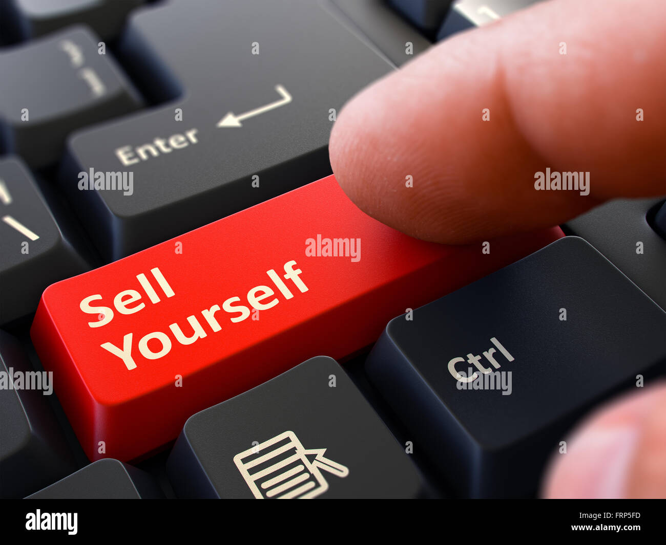 pressing red button sell yourself on black keyboard stock photo pressing red button sell yourself on black keyboard