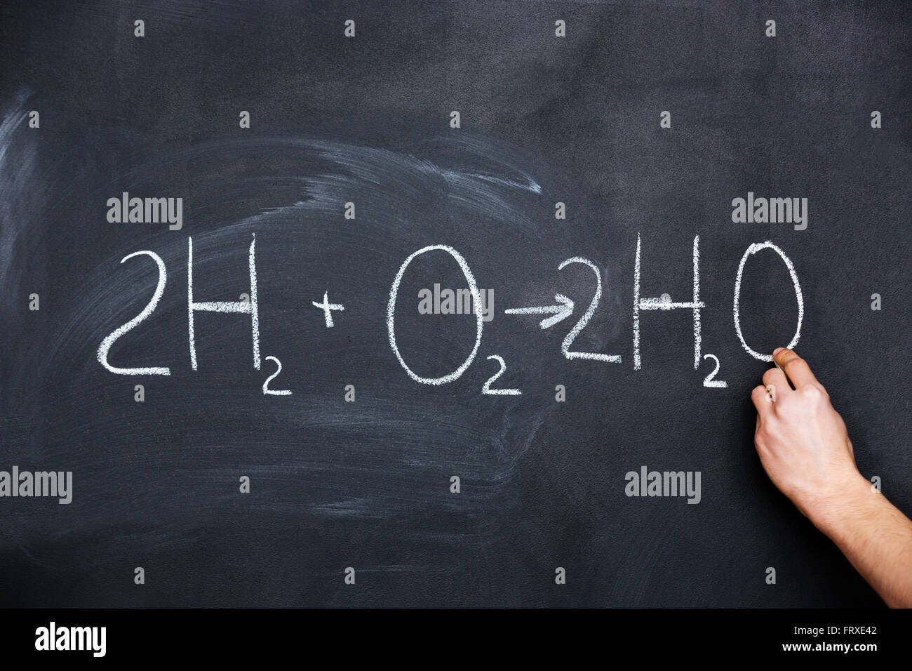 H2o chemical symbol stock photos h2o chemical symbol stock images hand writing chemical formula on blackboard with chalk buycottarizona Choice Image