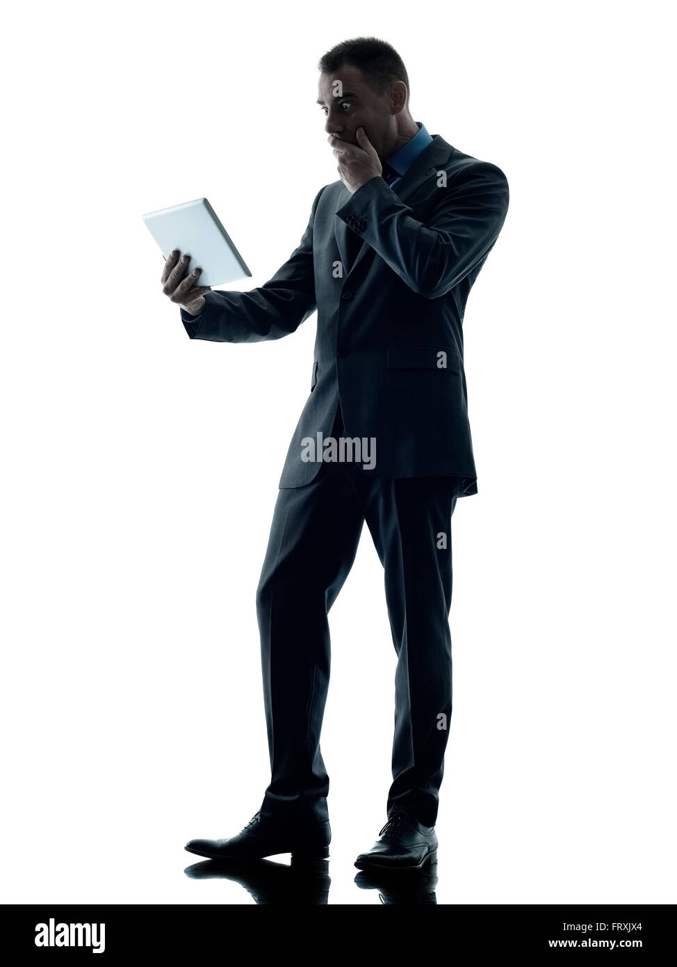 one caucasian business man standing using digital tablet ...