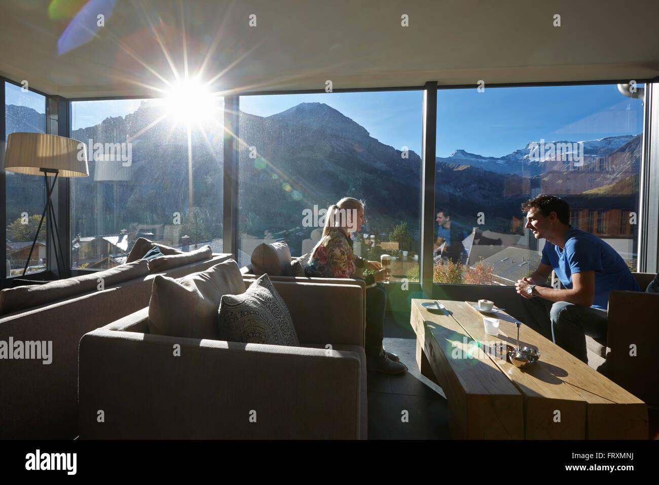 couple drinking coffee in a hotel winter garden adelboden canton