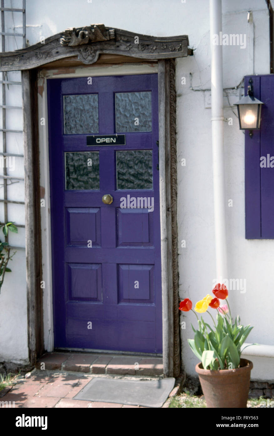 Close Up Of A White House With A Purple Front Door With A