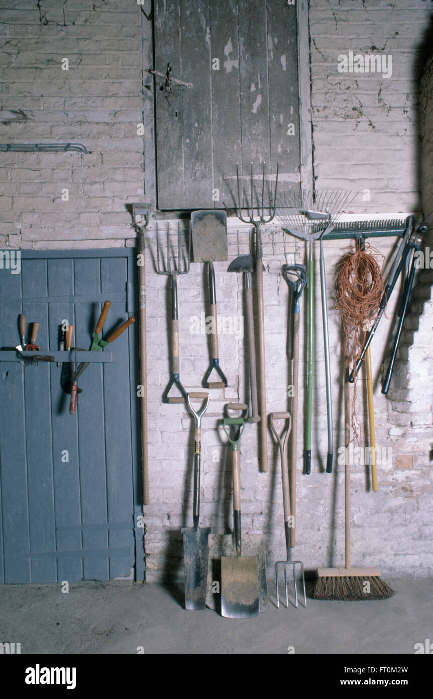 Gardening tools stored neatly on racks in a large garden for Large garden equipment