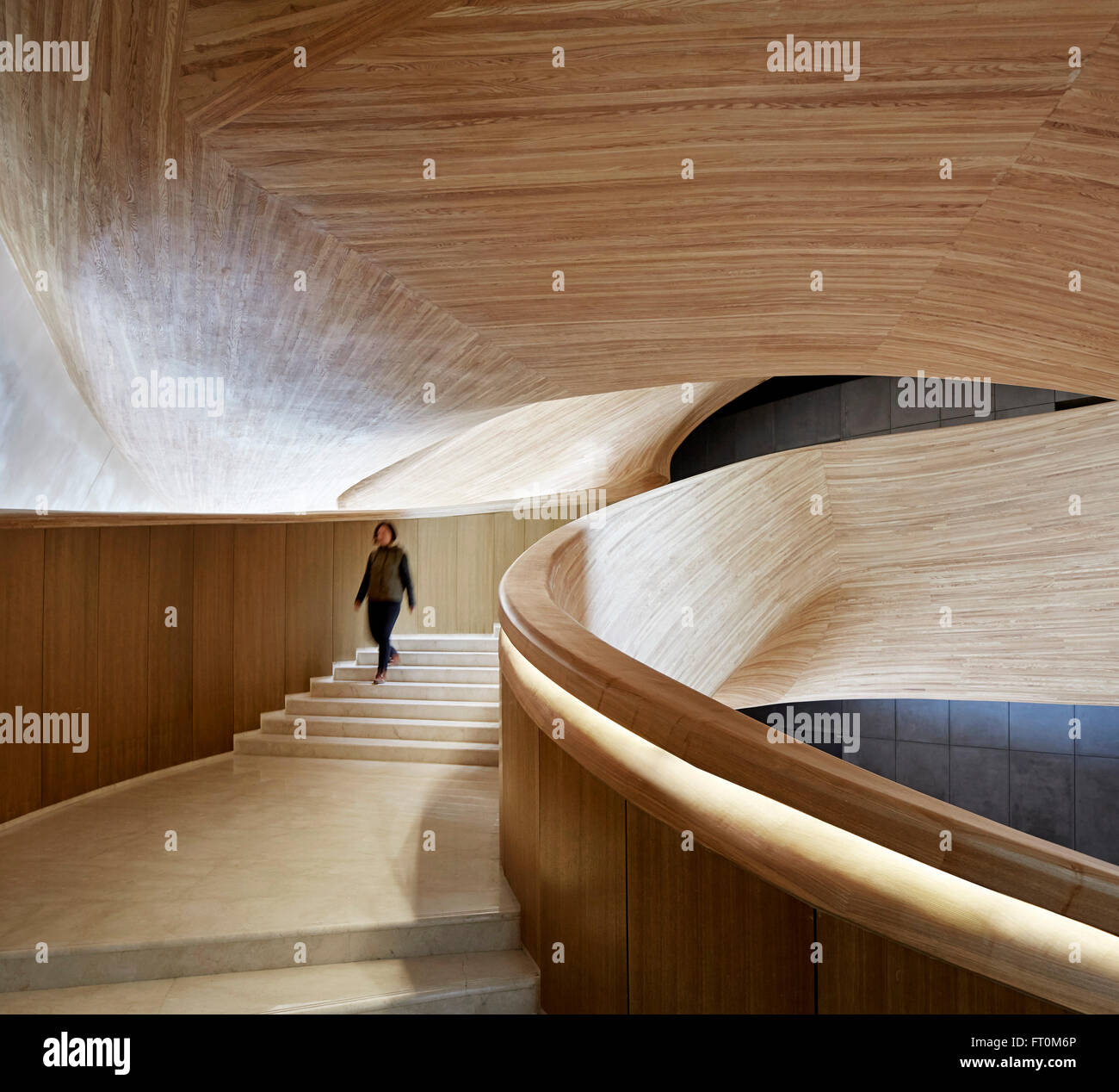 Winding stairway clad in timber harbin opera house for Beijing opera house architect