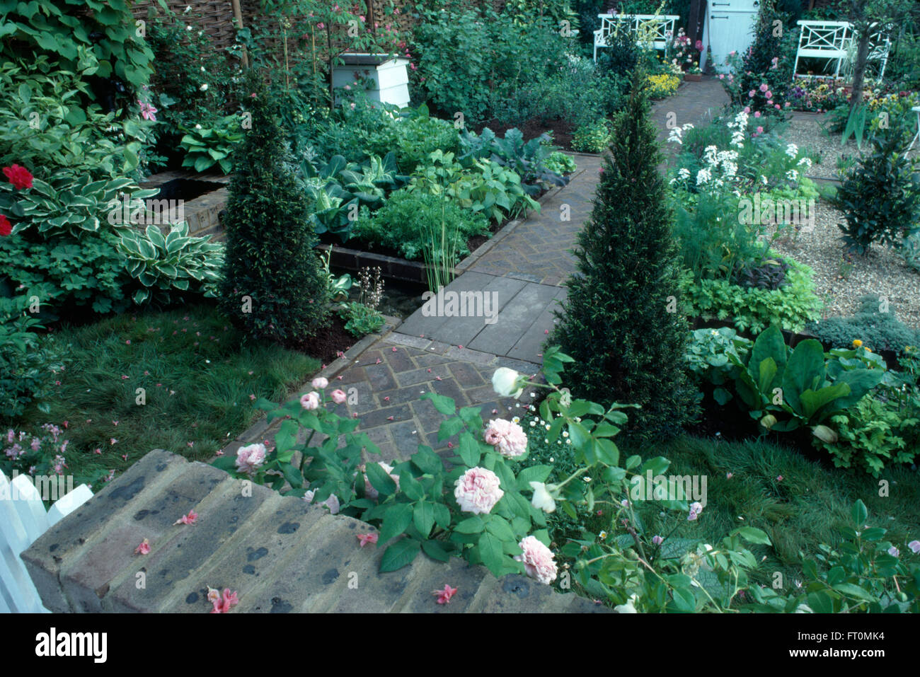 Pink Roses And Pyramid Box In A Formal Potager Garden With Brick Paths White Bee Hive
