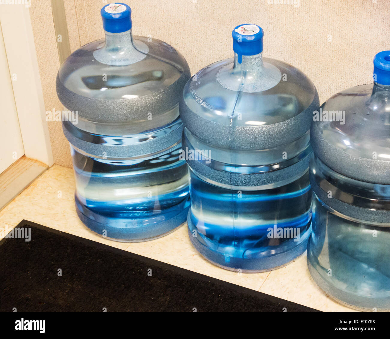 5 gallon stock photos 5 gallon stock images alamy three 5 gallon water bottles on the floor of a storage area in an office biocorpaavc