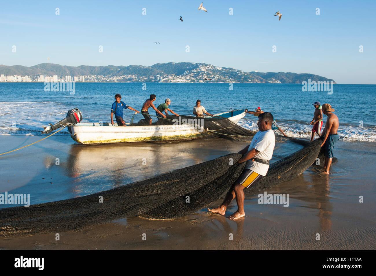 Fishermen carrying fishing nets playa las hamacas - Hamacas de playa ...