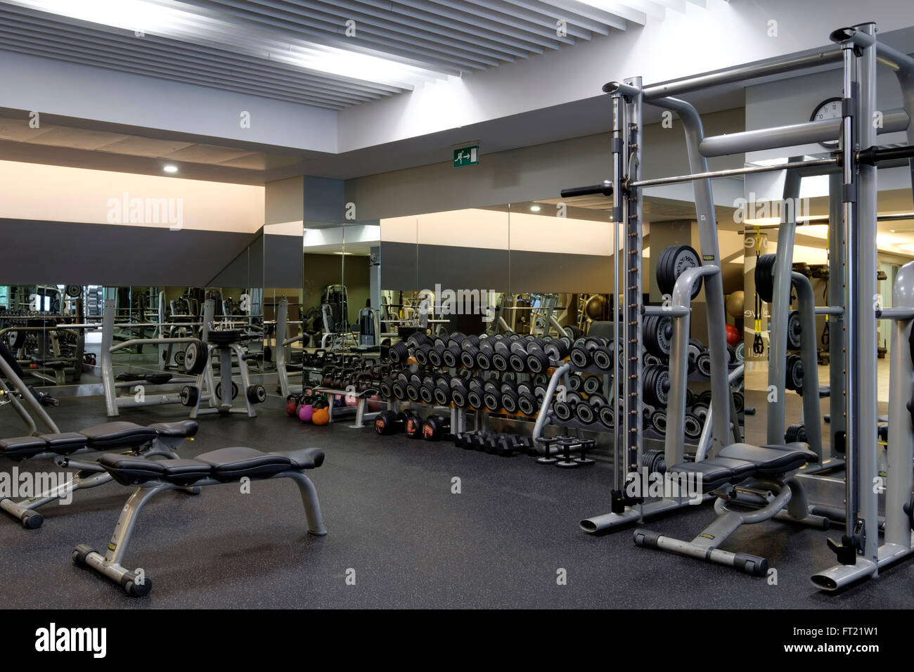 Weight lifting stations at an empty gym stock photo