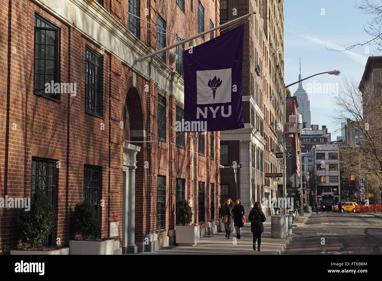 ... New York University Buildings With The Purple NYU Logo Flag Hanging  Outside The Entrance   Stock
