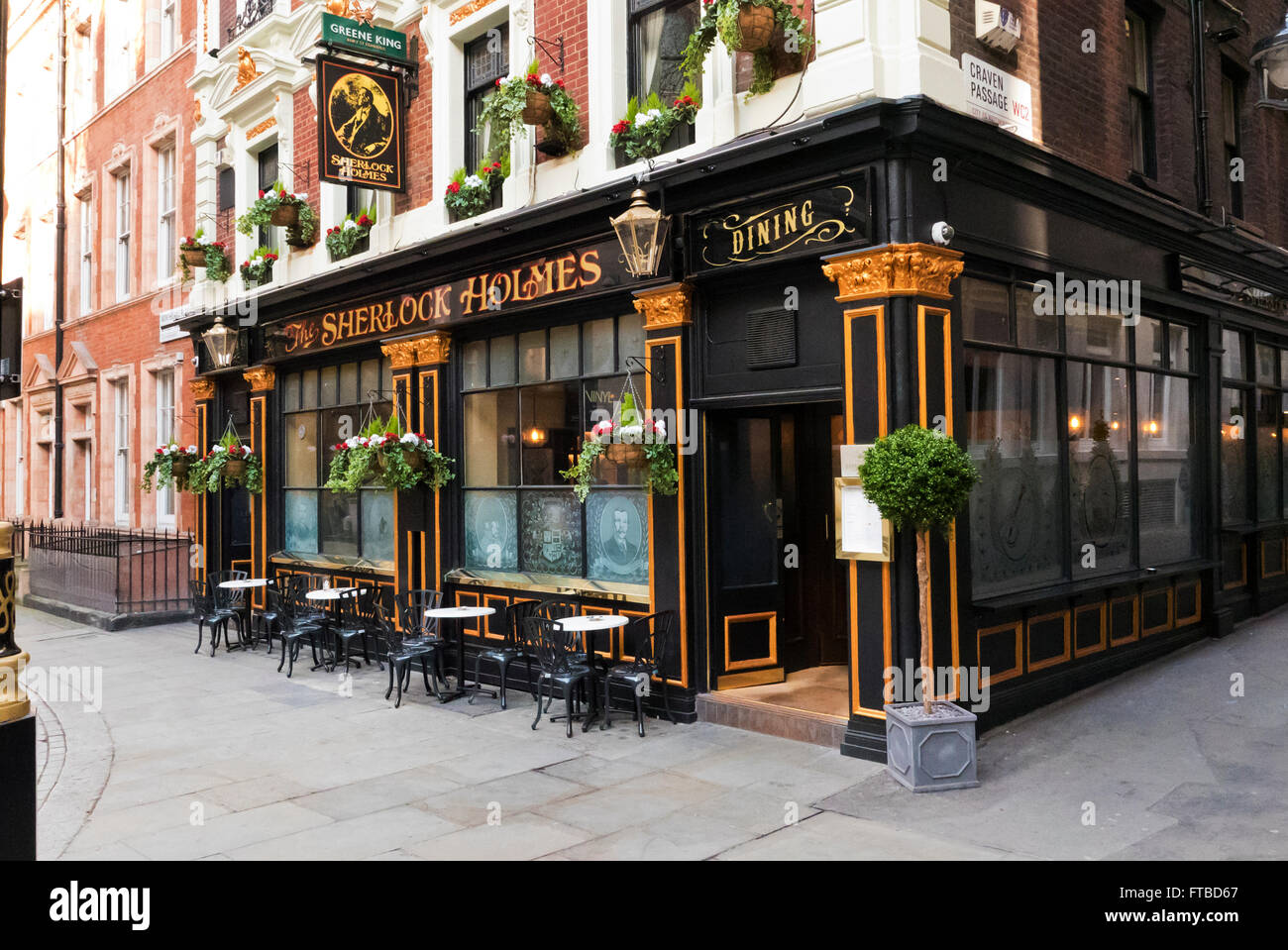 a traditional british pub with the famous detective name 39 sherlock stock photo royalty free. Black Bedroom Furniture Sets. Home Design Ideas