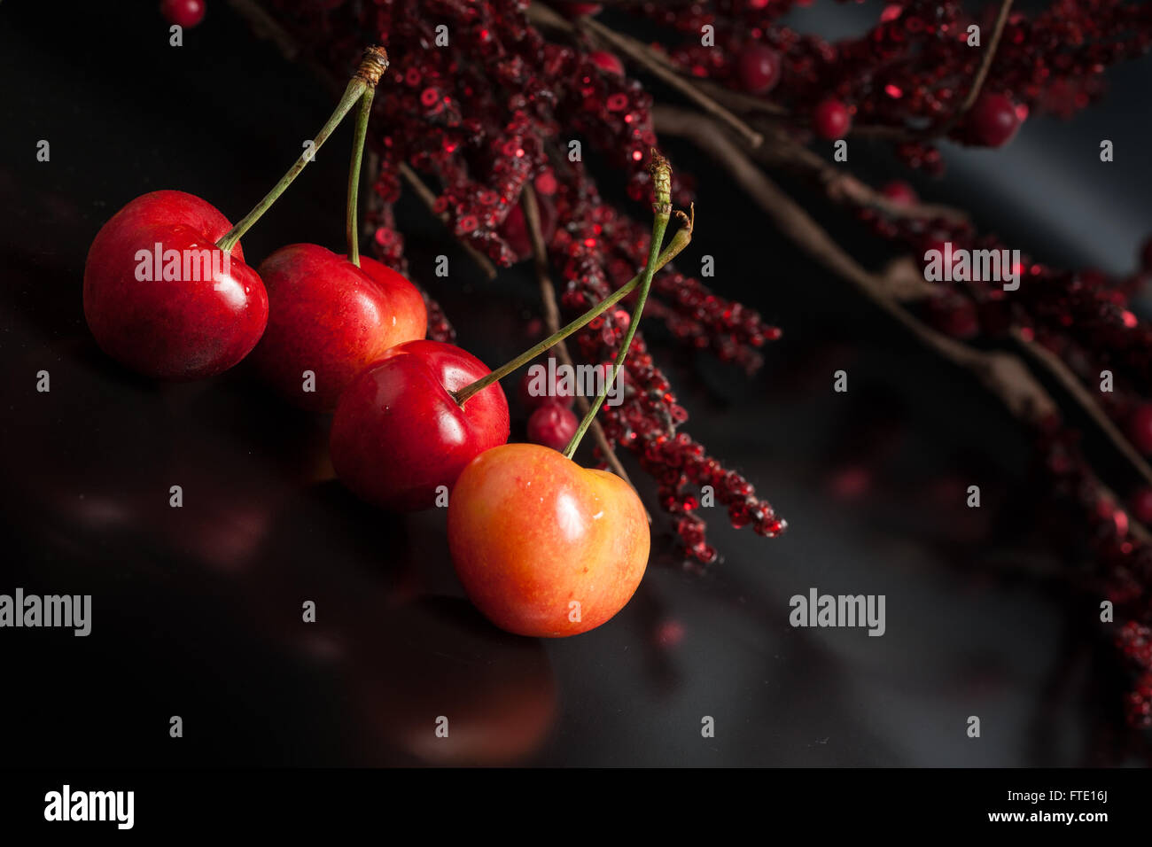Yellow cherry on black reflective background Stock Photo ...