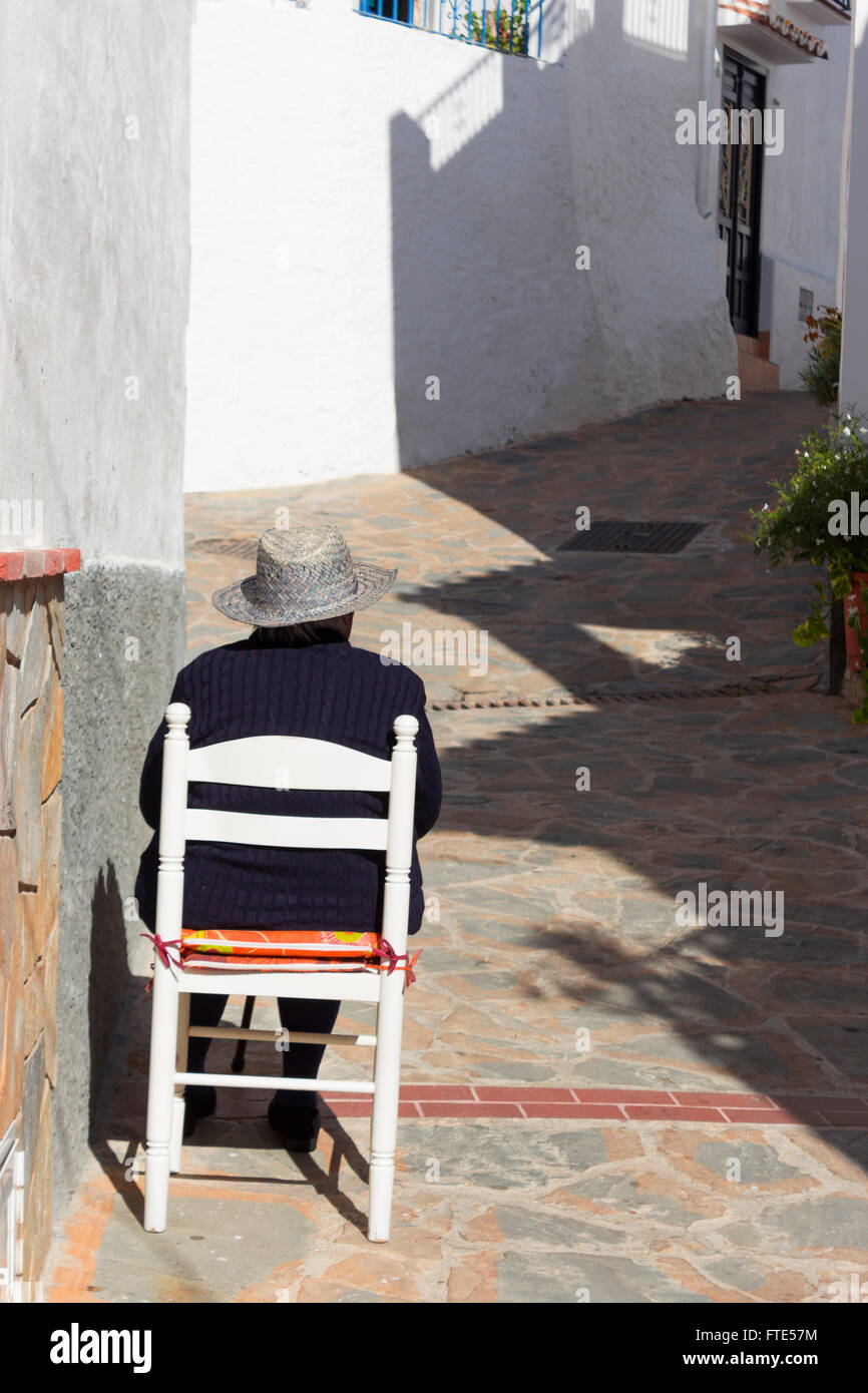 Back View Of Spanish Lady Sat In A Chair Outside Her House In The  # Muebles Mogar Malaga