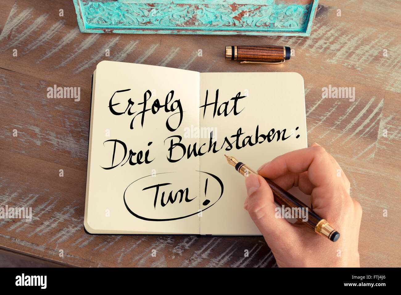 handwritten text in german erfolg hat drei buchstaben tun stock photo royalty free image. Black Bedroom Furniture Sets. Home Design Ideas