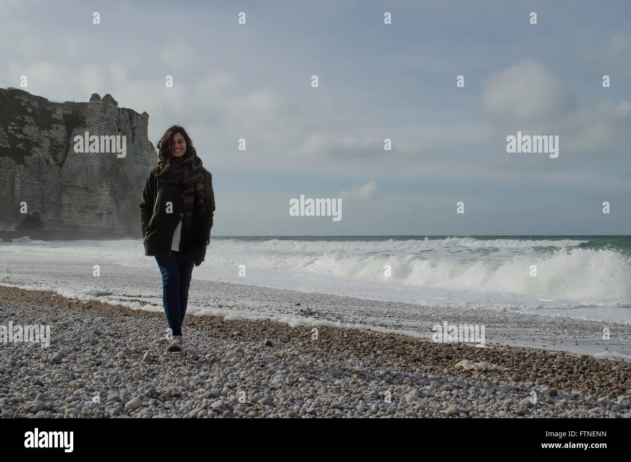 Woman walking on a beach royalty - Woman Walking On The Beach During Winter