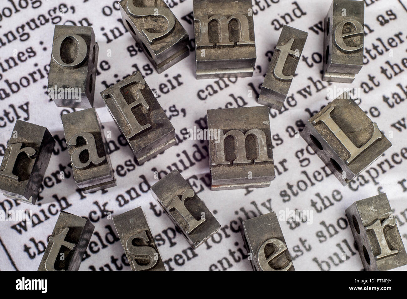 printing press block letters on newspaper print